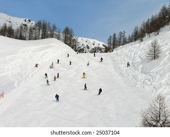 The big group of skiers on a mountain slope