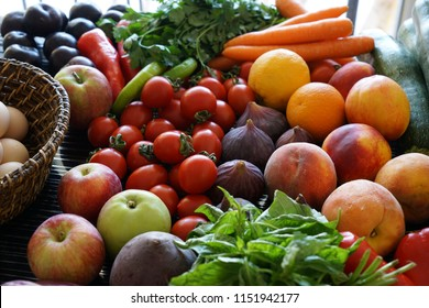 Big group of variety fresh raw vegetables and fruits. Close up. Full frame image. Overhead top view above mix veggies background.