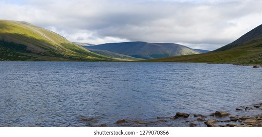 Big Hadatayoganlor lake in the cloudy August afternoon. Polar Ural Mountains, Russia