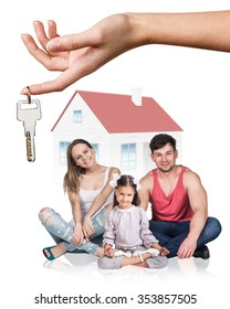 Big hand give keys to young family isolated on white background