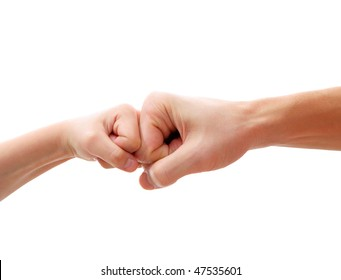 big hand and little hand as fists together