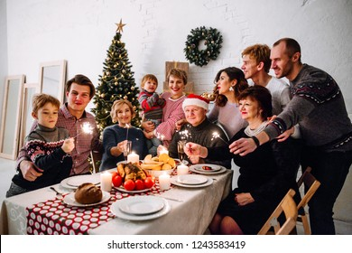 Big happy family celebrate Christmas by sitting at the Banquet table and prepare the Christmas duck