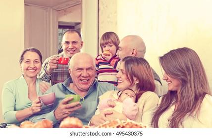 Big happy family communicate over tea