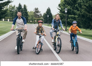 big happy family riding bicycles and spending time together