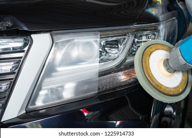 Big headlight cleaning on the car with power buffer machine at service station ,Before and after cleaning