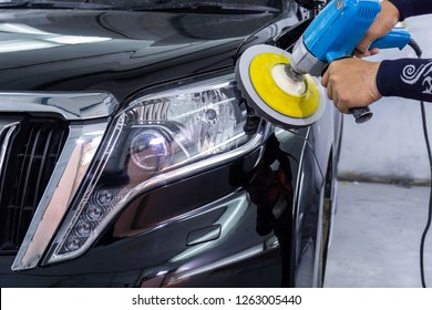 Big headlight cleaning with power buffer machine at service station ,Before cleaning