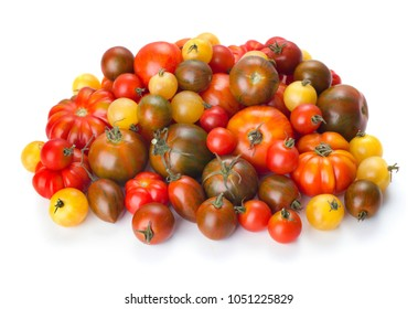 big heap of tomatoes isolated on white background