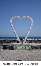Big heart on the beach near the ocean in Candidasa, Bali - Indonesia