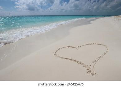 Big heart on the white sand beach