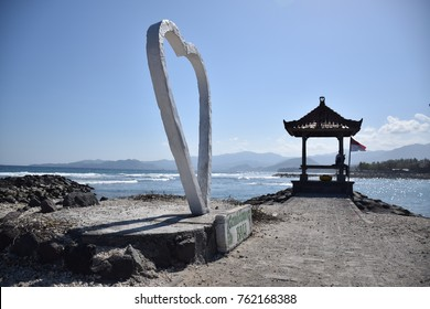 Big heart and a small pavilion on the beach near the ocean in Candidasa, Bali - Indonesia