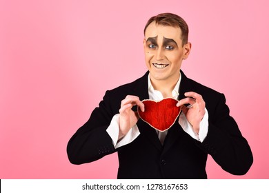 Big hearted. Happy mime falling in love. Mime man hold red heart for valentines day. Mime actor with love symbol. Theatre actor miming happy emotions. Love confession on valentines day.