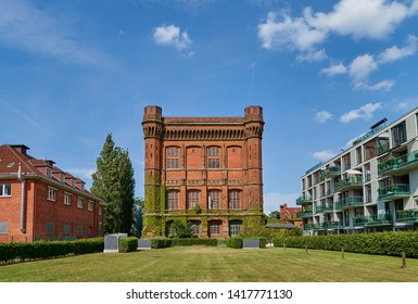 """big historic watertower building, officially """"watertower on the Werder"""", popularly called """"the upturned chest of drawers"""" in Bremen (Germany), completed in 1873 on a sunny summer day with blue sky"""