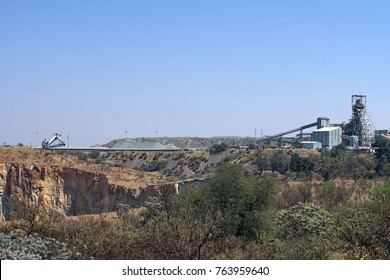 Big hole at the Cullinan diamond mine, with the plant in the distance, South Africa