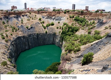big hole in kimberley, south africa, where De Beers diamond company originated and diamonds were dug out by hand. Largest man made hole on earth