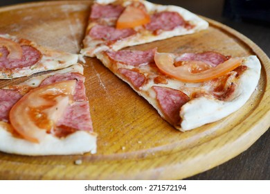 Big hot pizza with tomatoes and salami