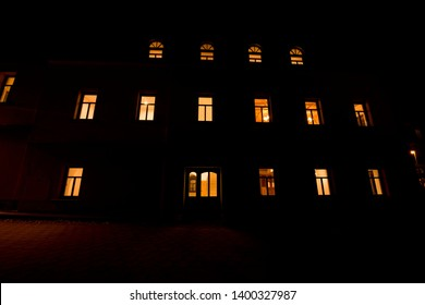 Big house at night with glowing windows