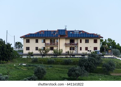 big house with solar panels covered roof