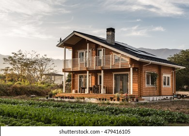 Big house wooden in village with beautiful sky and has good weather