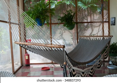 Big huge Hammock in black and white hanging inside a patio in colonial house in Granada Nicaragua