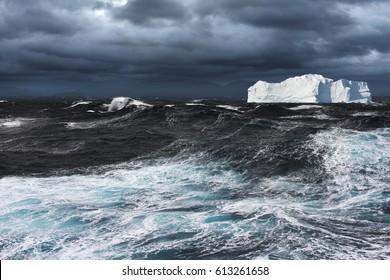Big Iceberg Drifting in Stormy Ocean