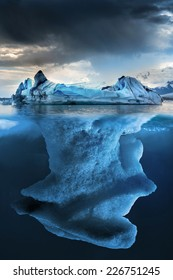 Big iceberg underwater with a small part floating