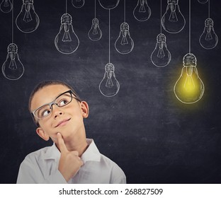 Big idea. Smart boy with solution lightbulb above head
