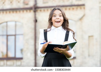 The big idea from the text. Happy little girl got main idea of book. Small cute child having genius idea from reading book. Reading for key idea and details.