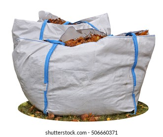 Big industrial bag from a synthetic sacking with the fallen down autumn maple leaves. Isolated with patch