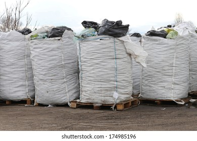 Big industrial bulk bags with recycling material at pallets
