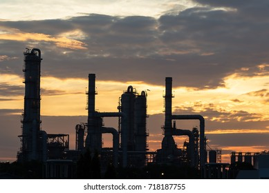 Big Industrial oil tanks in a refinery with treatment pond at industrial plants
