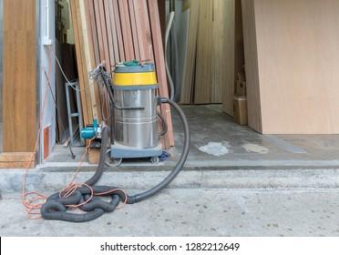 Big Industrial Vacuum Cleaner in Wood Work Shop