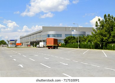 Big industrial warehouse with parking in front