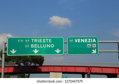 Big Italian highway sign with directions to go to Venice or in the cities of Belluno and Trieste