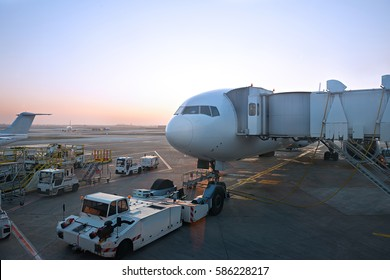 big jet plane preparing for pushback and departure in an airport evening lighting