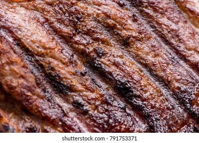 Big juicy grilled beef steak close up