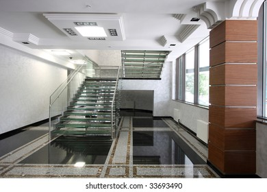 The big ladder from glass in a hall of office building
