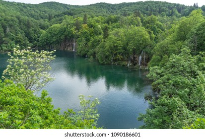 Big lakes with waterfalls flowing into it at Plitvice Lakes National Park in Croatia