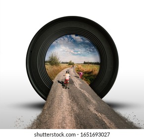 Big Lens Taking Picture of Family on Bicycles Trip with Spring Landscape on Background and Perspective Road on Foreground - Photograpy Concept