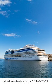big long travel cruise ship - blue sky and water -