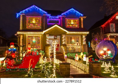 Big luxury house decorated and lighted for Christmas and for New Year Eve at Night at Vancouver, Canada.