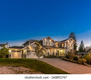 Big luxury house at dusk, night, sunrise time in suburbs of Vancouver, Canada.