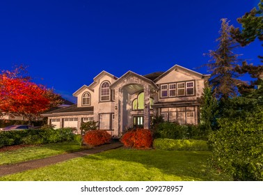 Big luxury house at night, disk, sunset, sunrise time in suburbs of Vancouver, Canada.