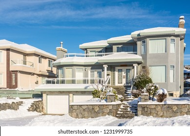 Big luxury residential house in winter season. North American family house on winter sunny day