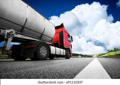 Big metal fuel tanker truck shipping fuel against blue sky