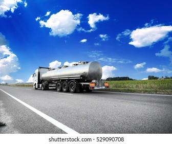 Big metal fuel tankers shipping fuel