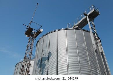Big metal fuel tanks and blue sky