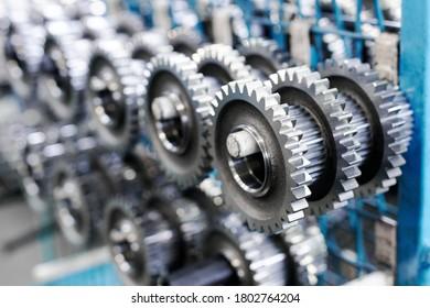 big metal gears on racks