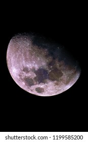 Big Mineral Moon, gibbous phase and with its natural colors, taken with telescope, isolated in dark background.