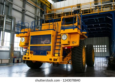 Big mining truck in the production shop of the car factory. Belaz is a Belarusian manufacturer of haulage and earthmoving equipment, dump trucks, haul trucks, heavy equipment.