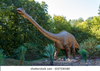 Big model of prehistoric dinosaur Brachiosaurus in nature. Realistic scenery.